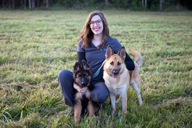 Image of woman with her pet dogs