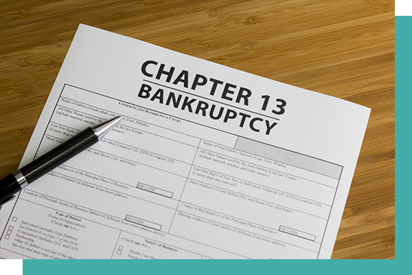 Image of Chapter 13 Bankruptcy form on counter with pen