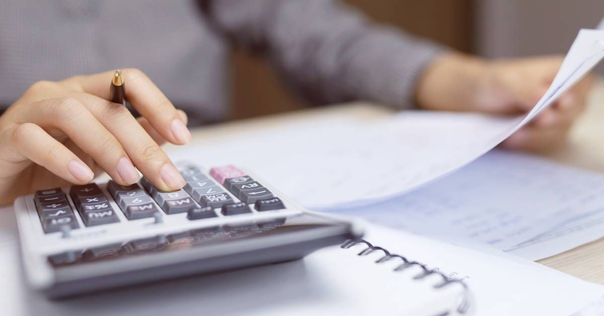 An image of a woman calculating financial information.