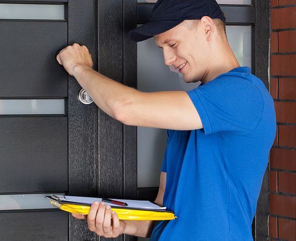 man knocking on a door