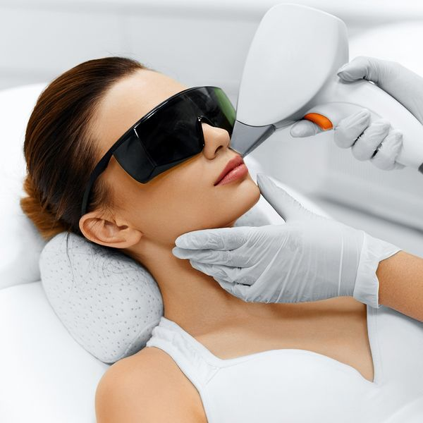 woman wearing glasses getting laser hair removal