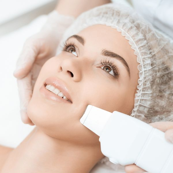 woman's face getting laser hair removal