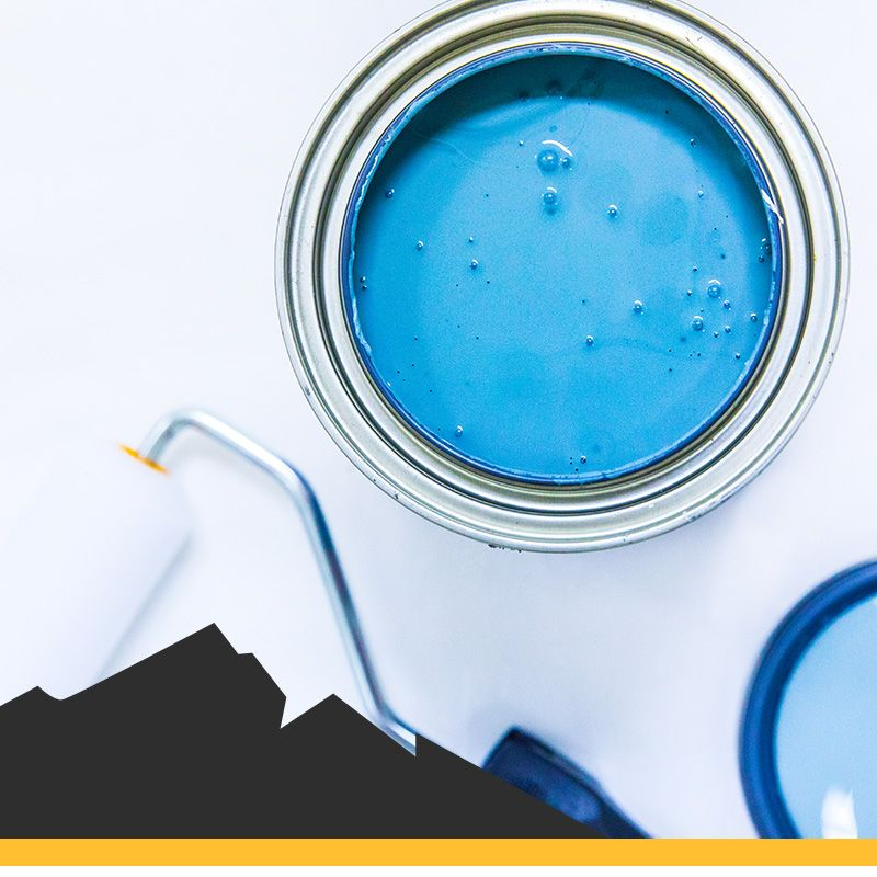 Blue cans of paint and a paint roller