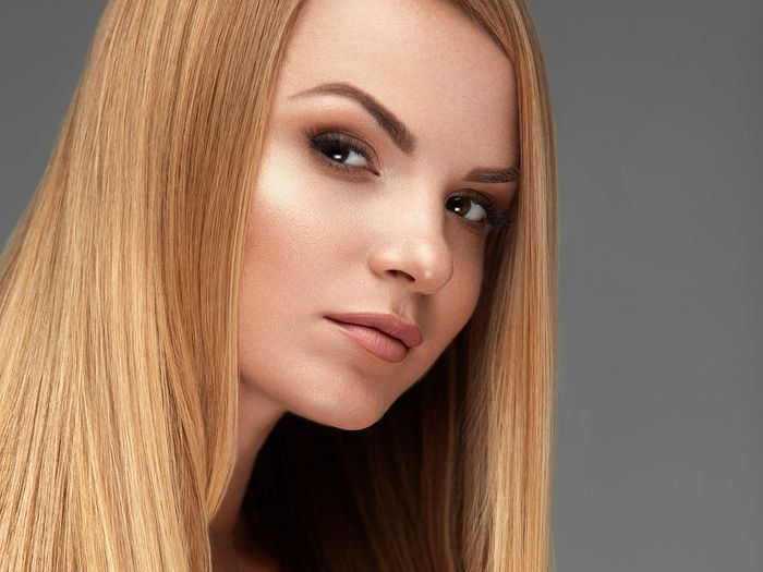 Woman with long, healthy, straight, blonde hair.