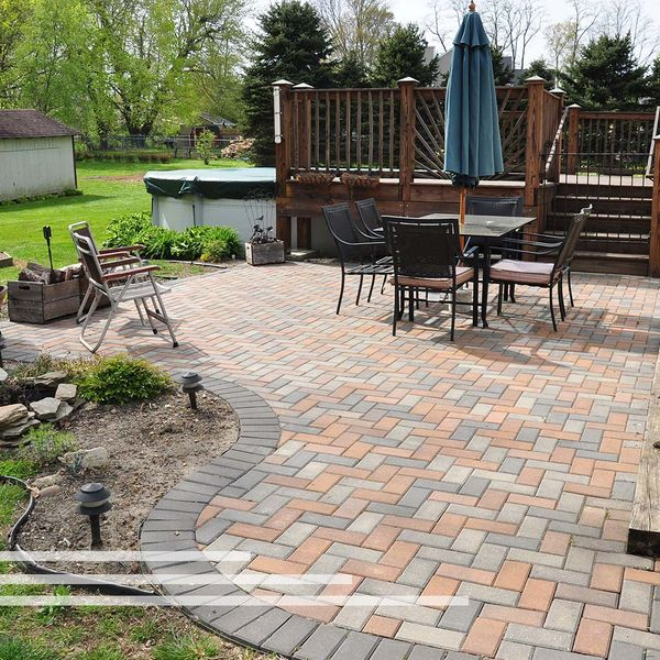 Landscaping with patio, deck, and water feature.