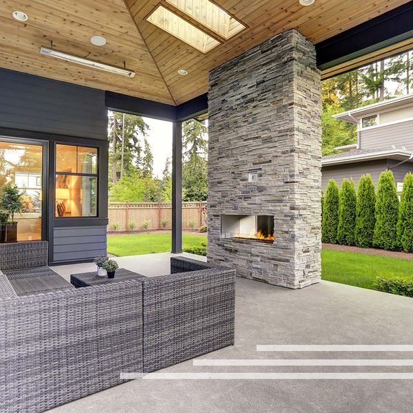 Stunning backyard with outdoor fireplace.