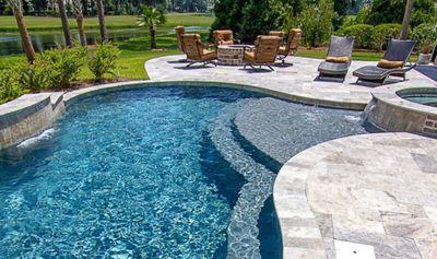 Residential multi-level pool and custom pool deck.