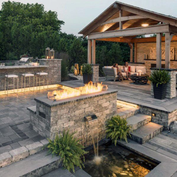 amazing-backyard-paver-patio-ideas-with-bar-and-covered-roof.jpg