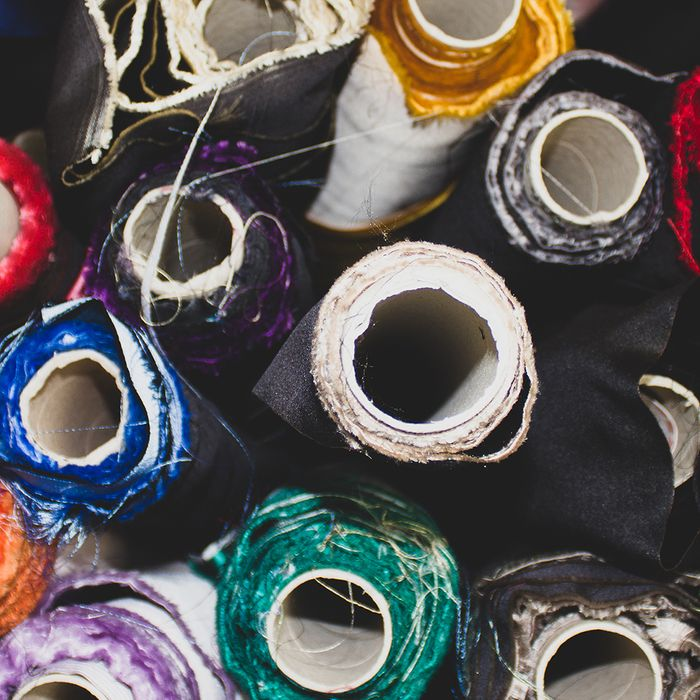 Image of different colored spools of Italian silk .