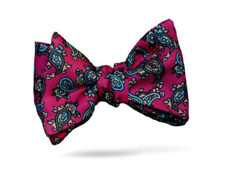 Bright pink bow tie with a blue paisley pattern throughout.