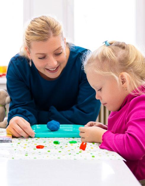 Teacher teaching young student