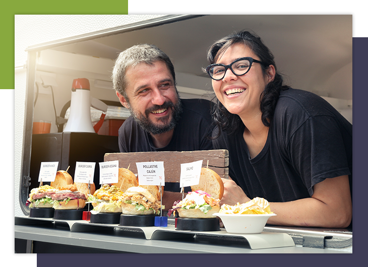 Image of two food truck owners