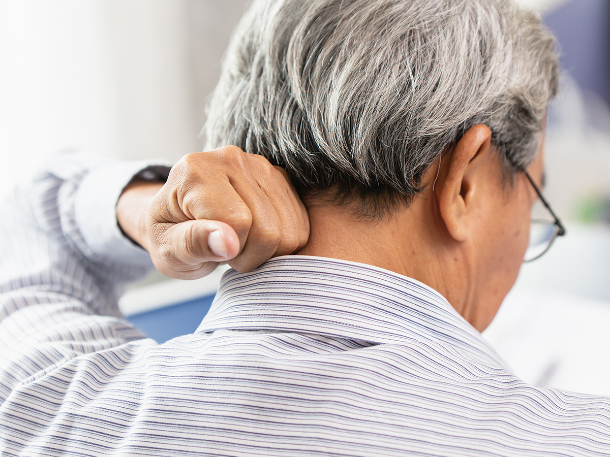Man experiencing neck pain.