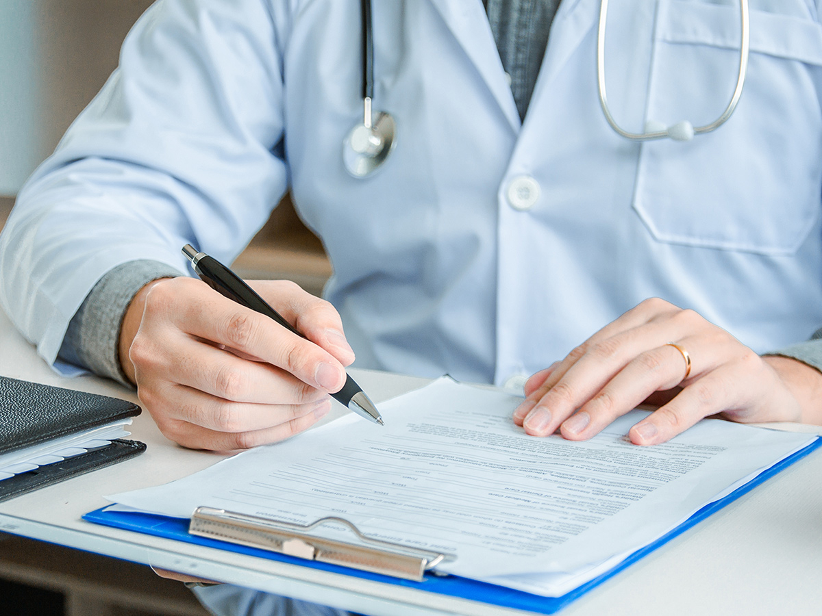 Doctor reviewing paperwork and planning patient care.