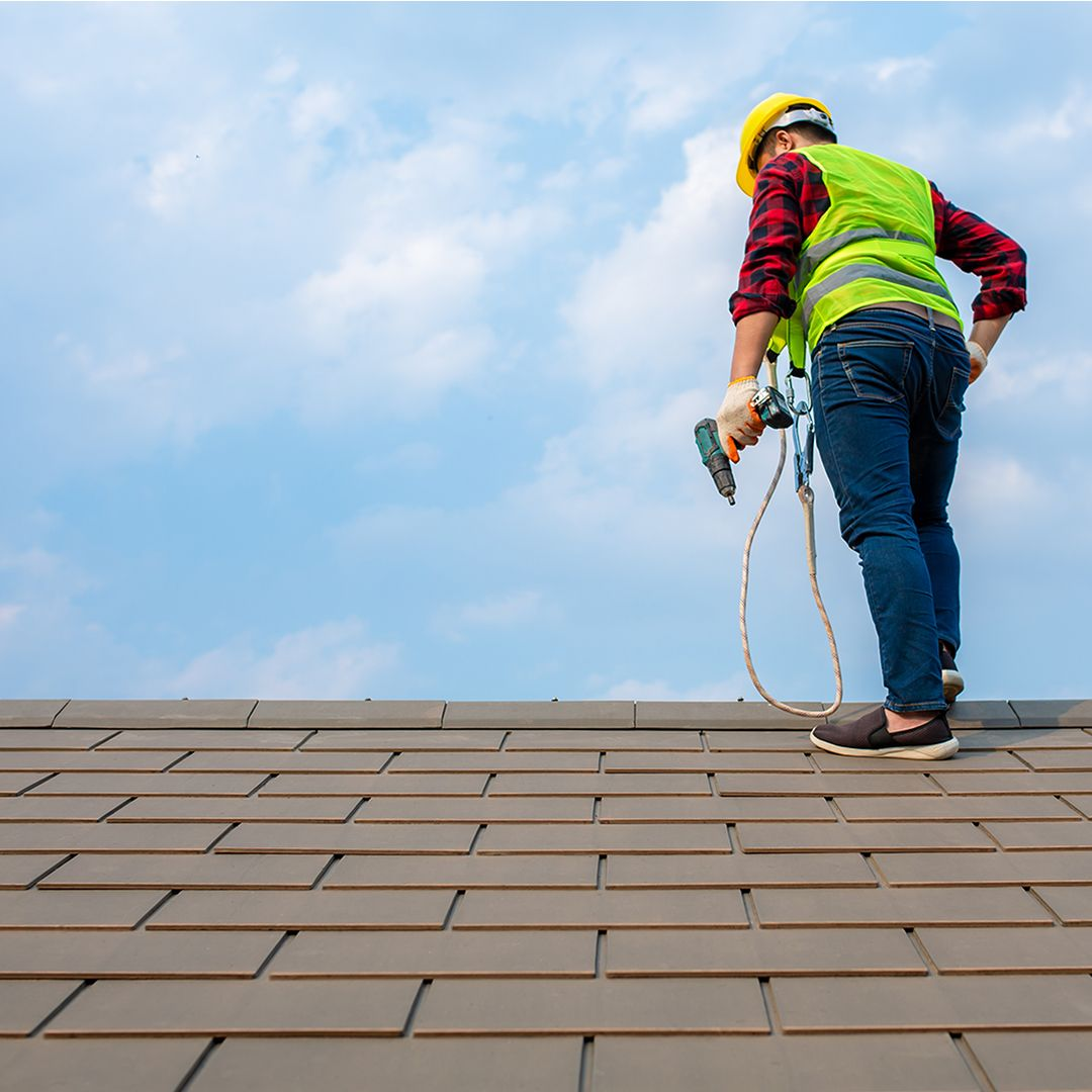 roofer working on repairing a roof