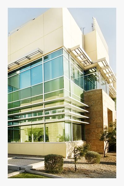 Image of a commercial building with landscaping