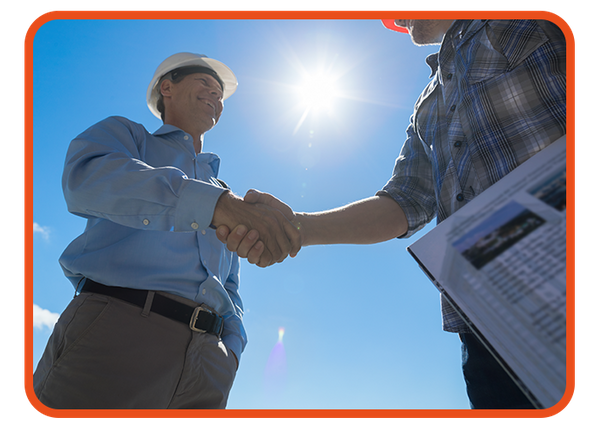 An image of a contractor shaking hands with an Estimate Fox staff member.