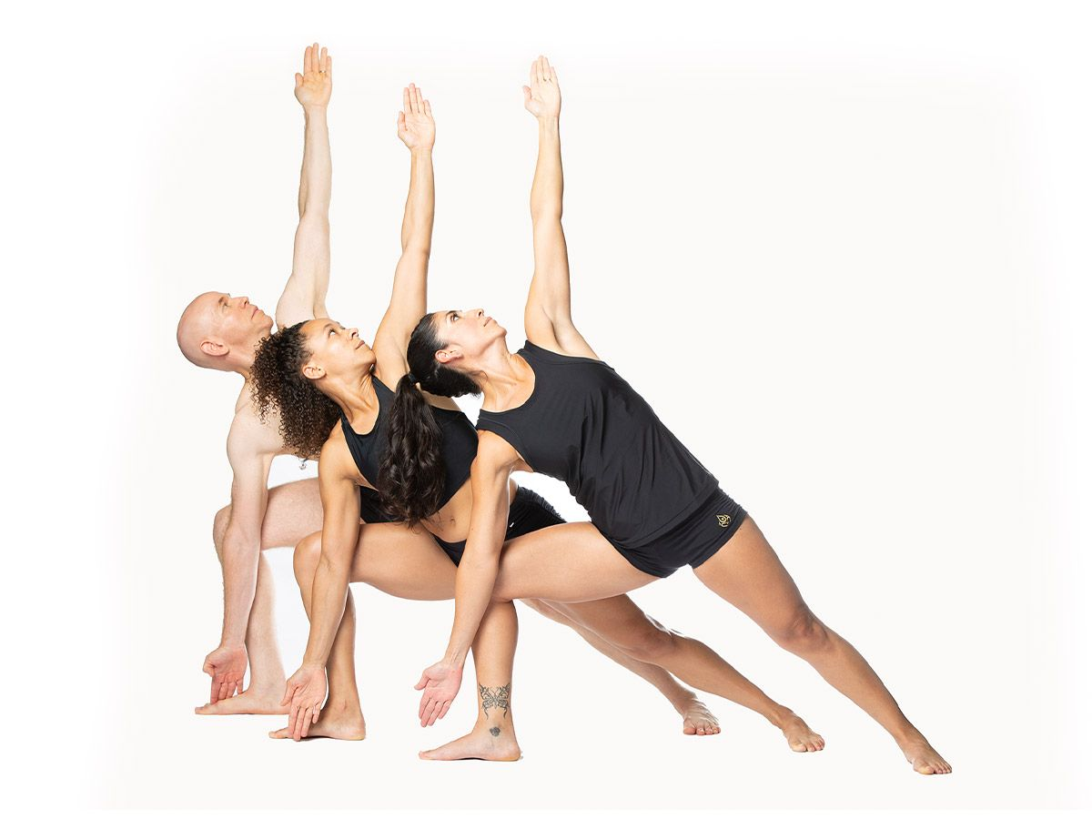 A group trying a relaxing yoga pose.