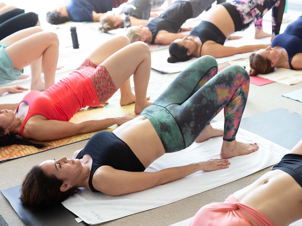 A group of women doing a yoga pose.