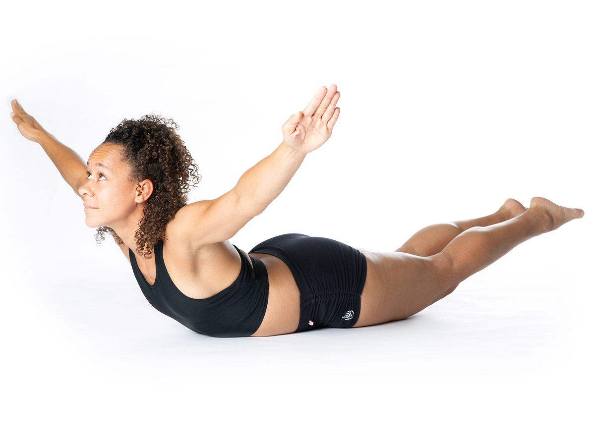 A woman stretching her back