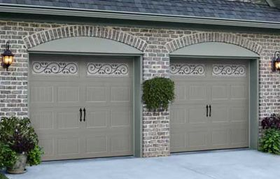 Gray garage doors on a brick house