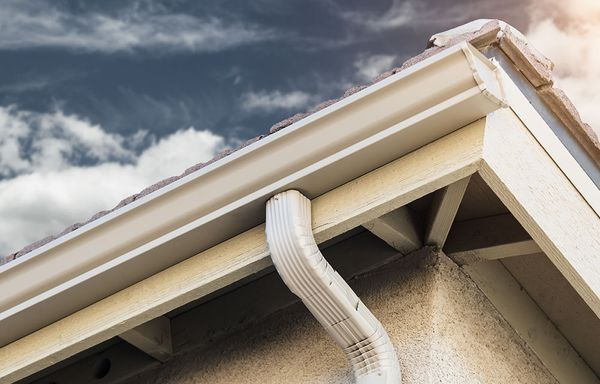 A home's gutter downspout.