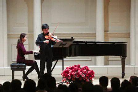 A young violin student of violin tutor Daria Hodko performing in Southern California