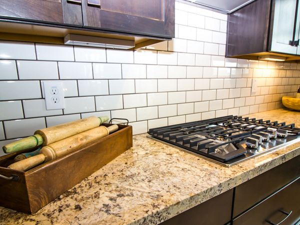 granite countertop with rolling pins and large bowl