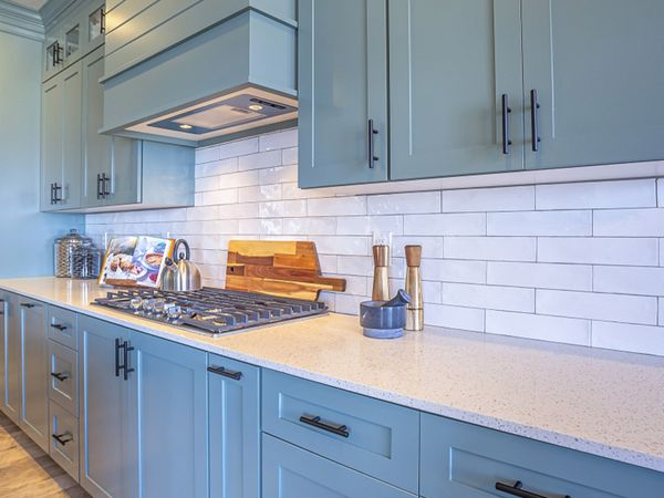 white countertop with blue-grey cabinets