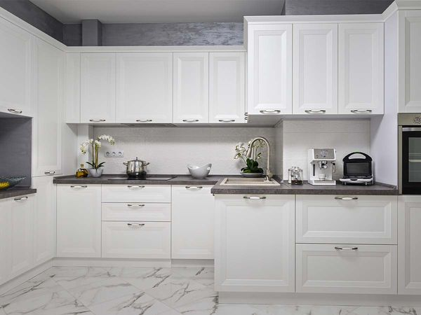 Clean and minimalistic modern white kitchen interior, front view