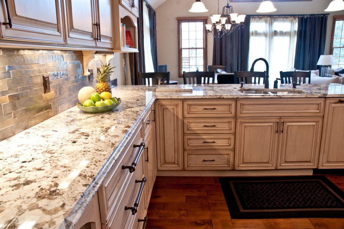 remodeled kitchen overlooking dining room with granite countertops