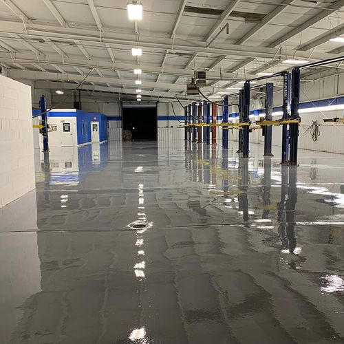 epoxied floor with car lifts