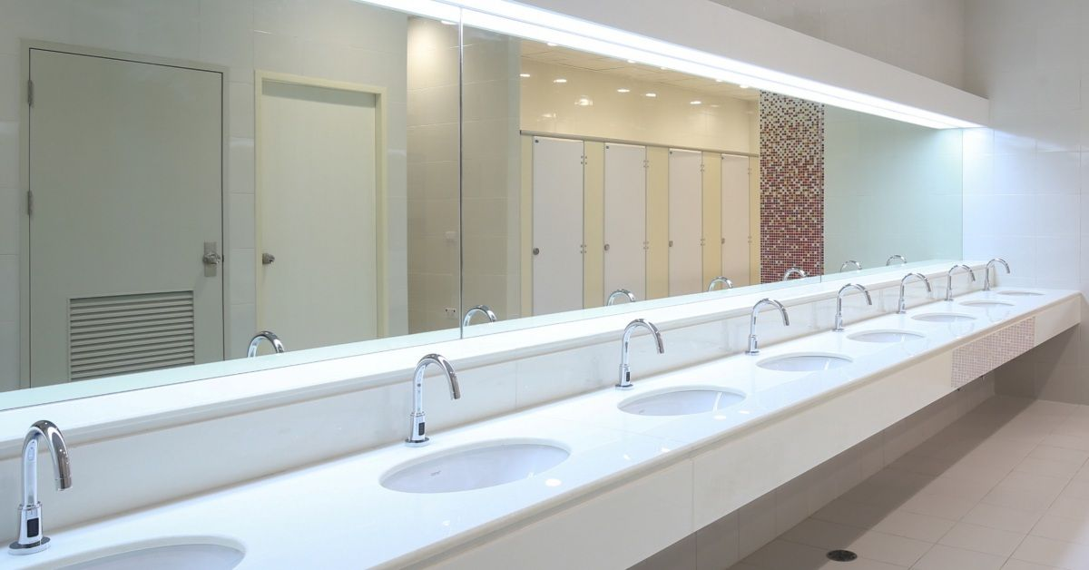 Image of a line of sinks in a public restroom.