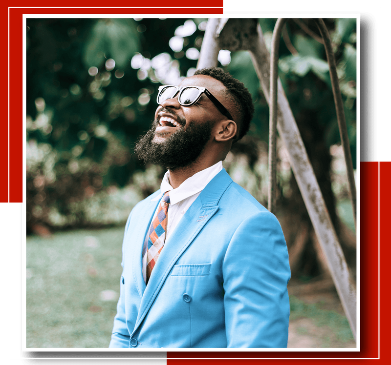 A black man in a suit laughing