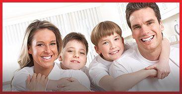 A family smiling at camera