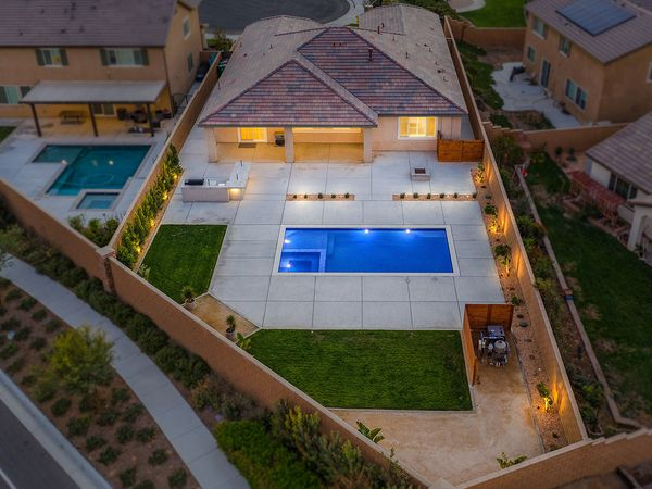 overhead  image of California backyard with pool at sunset