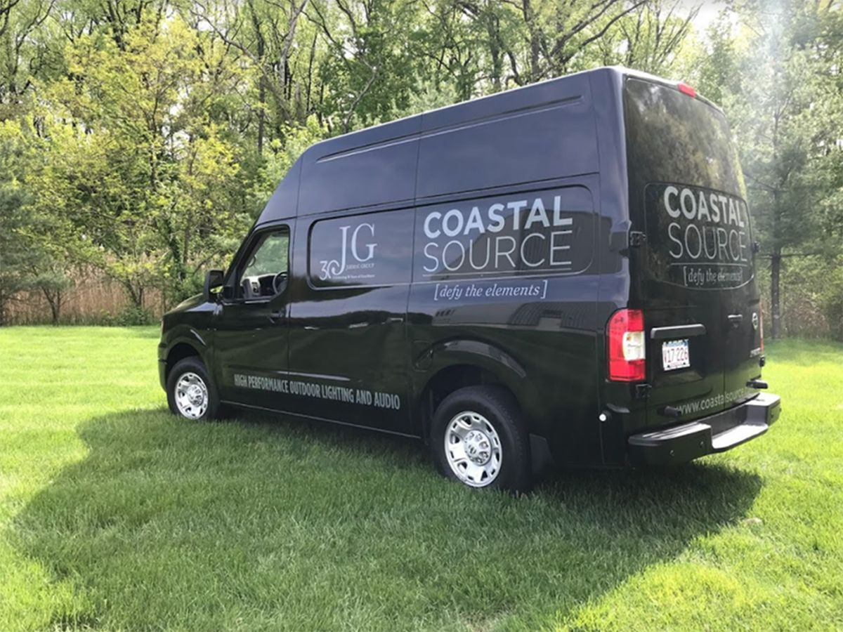 Image of a Coastal Source outdoor lighting and audio delivery van.