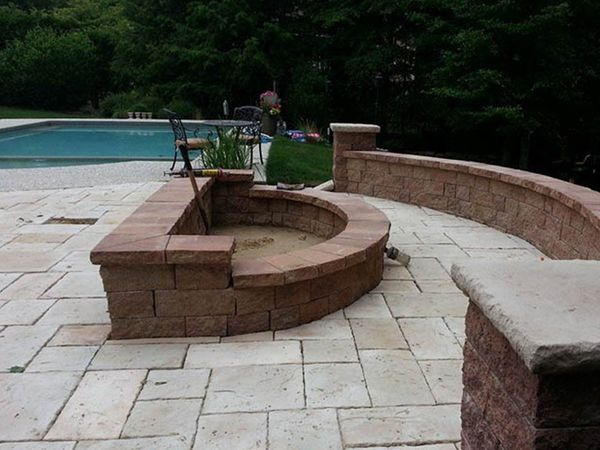 Image of backyard hardscape elements installed by Well Done Landscapes.