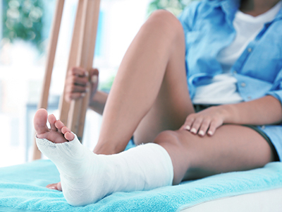 Woman with cast on ankle and crutches