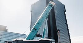 blue-crane-lifting-mechanism-with-hooks-near-the-g-GMDKECR.png