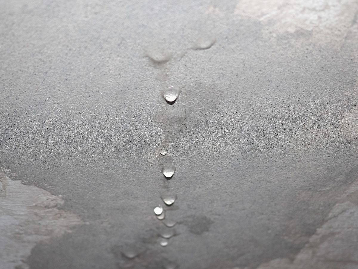 Water damaged walls may indicate a leaking roof