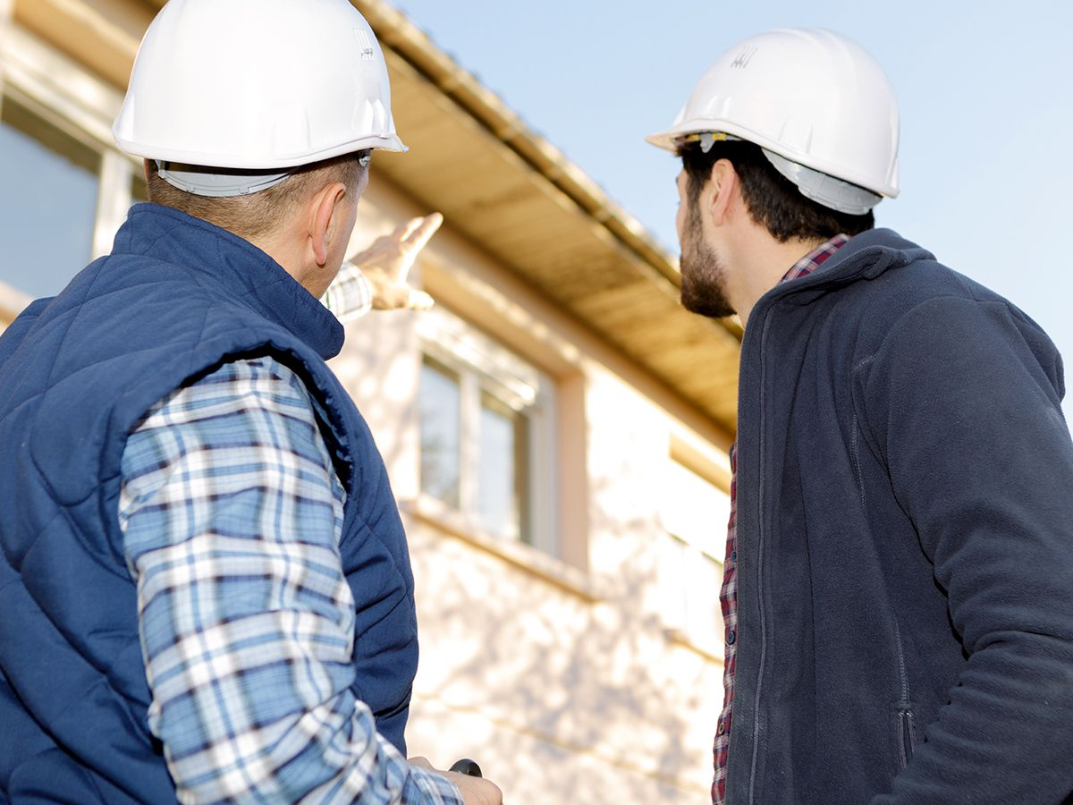 roofing contractors discussing work to be done