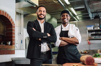 two employees in the kitchen
