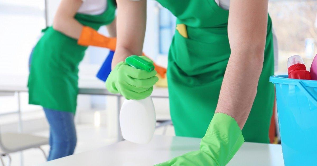 spraying tabletop surface while scrubing
