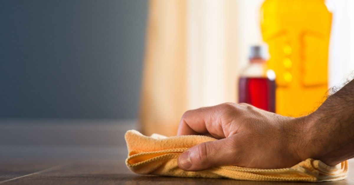 wiping down countertop