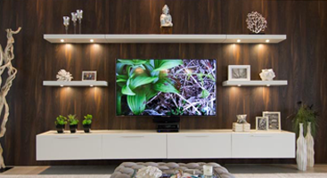 Image of a wall with a television and decor