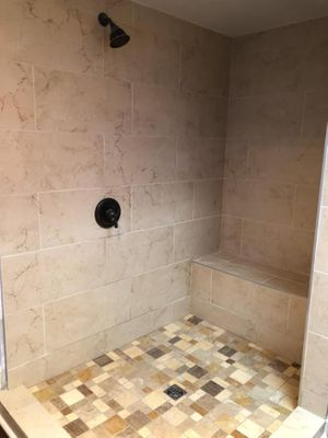 Close up of remodeled shower with custom tiling throughout