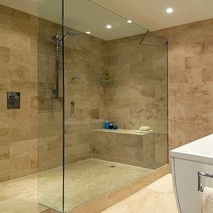 Image of large tile shower with swiveling showerhead