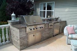 Image of outdoor remodeled grill and living area