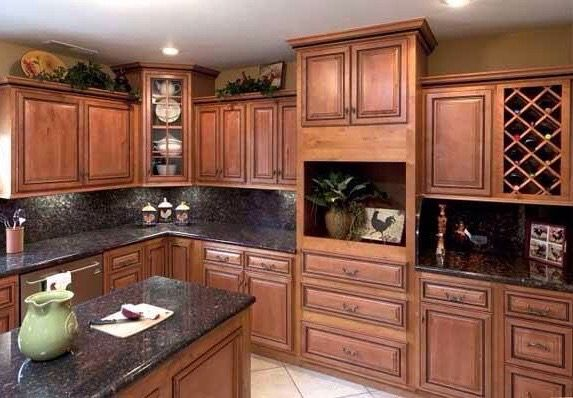 Image of custom wooden cabinetry and black marble countertops